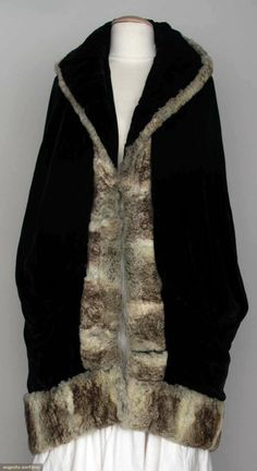 Black velvet coccoon shape, deep shawl collar, gray chinchilla trim, cream silk lining,