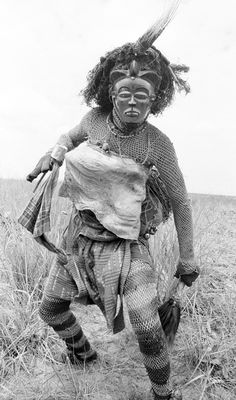 Africa | Pwo mask dancer from the Chokwe people. Near Gungu, Democratic Republic of Congo. 1970 | ©Eliot Elisofon