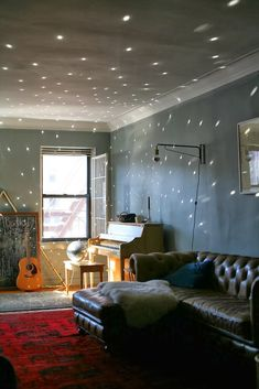 disco ball for light effects, also love the chalky green walls, leather, and rug