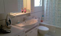 Washing maschine, steam iron, iron board, hair dryer, toilet paper, shampoo, shower gel.