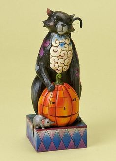 "Jim Shore Cats 2011  Scaredy Cat    A Halloween cat, with a pumpkin at his side, is preparing for the holiday.    Specifications:  Materials: Stone Resin   Size: 7""H x 3""W x 3""L  Note: Unique variations should be expected; Hand painted.    Your Price: $31.00"