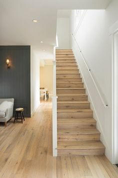 """Farmhouse by Richardson Architects floors of reclaimed white oak. """"The floors are rustic, but because of their color, they make the rooms feel light and airy,"""" says Richardson. White wall paint: White Dove, Benjamin Moore; gray wall paint: Kitty Gray, Benjamin Moore; floors: The Heritage Timber Edition in Lintel, DuChateau"""