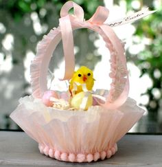mini easter basket: nut cup + crepe paper + embellishments  cute little gift basket!