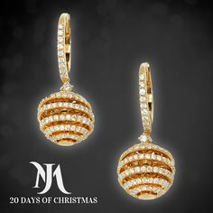 Diamond earrings, crafted with 18 carat yellow gold, crafted into a classic hoop and ball design, are simply beautiful.www.moraysjewelers.com