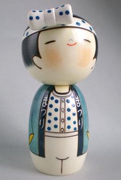 Design: wears a blue Hanten (Kimono for festival) and Hachimaki (headband). About Kokeshi Kokeshi are Japanese dolls, originally from Tohoku-northern Japan. They are handmade from wood which are Mizuki or Kaede in Japanese, suit for making dolls. Momiji Doll, Kokeshi Dolls, Matryoshka Doll, Wooden People, Asian Doll, Japanese Embroidery, Little Doll, Wooden Dolls, Japanese Art
