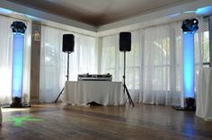 Vertical Lighting Truss with white truss cover, LED uplighting, and Intelligent moving head effects lighting for dance floor in the Harbor Room on the second floor at the Battery Gardens Restaurant.