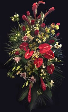 Standing sympathy spray of anthurium, Hawaiian ginger, cymbidium orchids, asiatic lilies, red roses and white alstromeria. Designed by Alice Woodside Lynch for Bennett's Flowers, Jonesboro, AR.