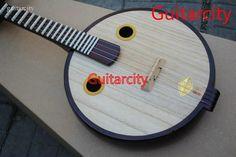 Google Afbeeldingen resultaat voor http://i00.i.aliimg.com/wsphoto/v0/480669284/Cheap-Ruan-font-b-Lute-b-font-of-Chinese-Musical-font-b-Instruments-b-font-2011.jpg