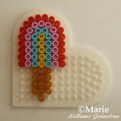 Cute mini rainbow color popsicle made with a heart shape peg board and fused Perler or Hama beads. Perler Bead Designs, Easy Perler Bead Patterns, Melty Bead Patterns, Hama Beads Design, Diy Perler Beads, Bead Embroidery Patterns, Perler Bead Art, Beading Patterns, Loom Patterns