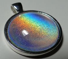 NfuOh 61  1'' Circle Nail Polish Jewelry Pendant by Coloruza, $8.00 love it! must try! www.eCrafty.com for glass tiles, bezels, bails, jewelry supplies