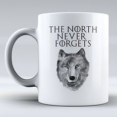 "$12.99 Funny Mug - The North Never Forgets - Quote Game of Thrones - Jon Snow Lives - Jon Snow - Winter Is Coming - Funny - Gifts - Coffee Mug - Ceramic Coffee Mug - This a Perfect Gift - Have a Nice Day ""sold by Sunrise Shop Group LLC"" http://www.amazon.com/dp/B017HY9ICW/ref=cm_sw_r_pi_dp_Zjd.wb0YS6RAG"