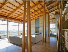 Contrast between the lightness of the wooden roof structure and the mass of the rammed earth walls at Bodega Bay Residence in California by Cutler Anderson Architects