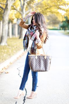 Shes all about her scarves and Louis Vuitton bag dress to impress for weekend fun via Ecstasy Models