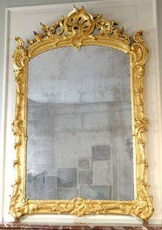 "Very fine, early Louis XV period over-mantle mirror: In solid, carved giltwood with original mercury glass.  Circa 1735-1740.  73"" high by 47¼"" wide"