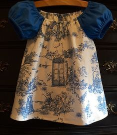 Doctor Who Tunic made from custom designed and printed toile de jouy cotton fabric. This tunic has contrasting blue puff sleeves. Peasant style