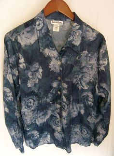 This is a gently worn Carol Rose abstract blue white casual career long sleeve M Women's Top Blouse. This is a very pretty top with shades of blue and white, very artful pattern. This is a shirt cut style that buttons up the front. There are seven buttons that look like a dark mother of pearl up the front, and a button on each cuff. The fabric has a slight random krinkle. Very lightweight.
