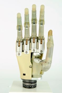 """""""The i-limb, a bionic prosthetic hand, is currently the most advanced artificial hand available. Each finger is independently driven by a motor and fully articulate. The thumb is rotatable through 90 degrees, so the hand replicates the function of a human hand.The hand is controlled by electrical impulses created by contracting muscles, which are picked up by electrodes in the wrist and interpreted by a computer in the back of the hand. """""""