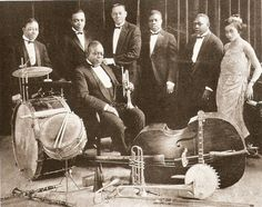 King Oliver's Creole Jazz Band (1923)  Left to right: Baby Dodds, trombonist Honore' Dutrey, Joe Oliver, bassist Bill Johnson, Louis Armstrong, clarinetist Johnny Dodds, and pianist Lil Hardin (whom Louis would later marry and divorce).