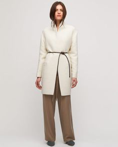 Cut from a wool mix, this belted cocoon coat is a subtle statement this season. Features include a ribbed effect, reminiscent of a tree's texture, a self-covered popper fastening, laid-on welt pockets and a shoestring belt with chain link belt loops at side seam. Revamp your outerwear collection this season with this go-to piece.