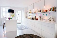 LOVE this kitchen... that shelf running across is perfect!