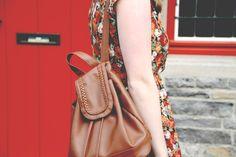 rose print dress + tan backpack