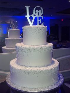 Sparkly smooth iced buttercream with sugar silver and pearl balls on this wedding cake. LOVE this !