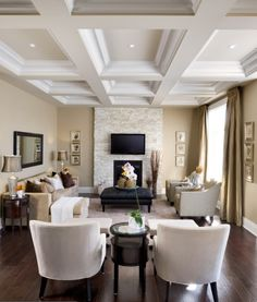 Ivory and beige living room with dark floors.