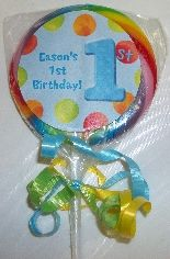 Personalized lollipops for 1st birthday party.  See more first boy birthday and party ideas at one-stop-party-ideas.com