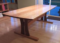I built this table about a year ago now, and I finally got around to posting it. I've always like the trestle table design, so here is my interpretation of it. The top is a glue up of several boards and is inches thick; Wood Slab Dining Table, Timber Table, Dinning Room Tables, Trestle Dining Tables, Dining Table Design, Wooden Tables, Diy Kitchen Shelves, Esstisch Design, Tabletop