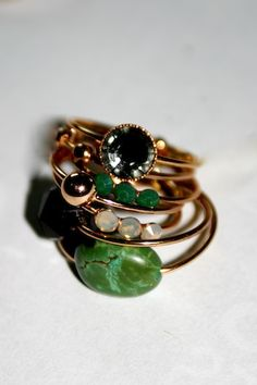 Love the tone of this gold against the jade and emerald hues of the stones. A beautifully eclectic yet complimentary stack of rings.