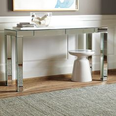 Coveting Parsons Mirrored Console.   Thinking twice when picturing sticky finger prints all over the legs.