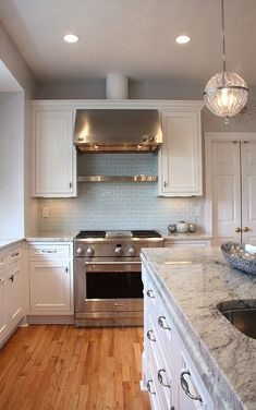 Love The Cabinets Backsplash And Countertops    Modern Kitchen Bianco  Romano Granite Countertop White Cabinets Wood Flooring
