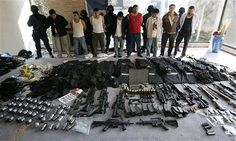11 alleged hit men working for the Sinaloa drug cartel were captured at two Mexico City mansions stocked with grenades, automatic weapons and body armor. 2008