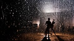 Wayne McGregor | Random Dance in the Rain Room by Barbican Centre. Dancers from Wayne McGregor | Random Dance inhabited rAndom International's acclaimed Rain Room installation in the Barbican's Curve gallery, performing continuously evolving interventions in the Rain, with a score by contemporary composer Max Richter.