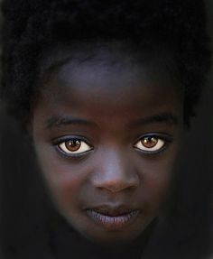 Visiting the tribes in Ethiopia's Omo Valley, I stopped at the Omo Child Home in Jinka. I noticed this beautiful girl with big eyes looking out from the dark