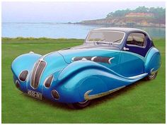 This 1936 Delahaye is spectacular!  The lines of the car are unbelievable.  I could sit and look at this car all day long.  (Or steal the keys and never stop driving)