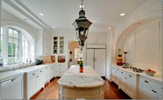 Skinny and long island notice the built in arches on wall span.  white kitchen image   All white kitchen – cabinets, walls, and countertops. Gorgeous ...