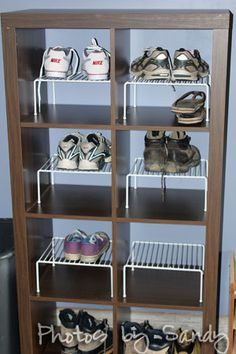 Mud room storage in the garage - white shelf dividers keep air circulating around shoes and makes for easy clean-up