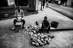 Young brothers prepare coconuts for selling.  #olbedesign #500px #photography #Africa #street