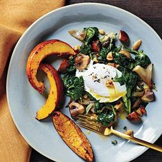 Poached Eggs with Spinach and Walnuts served with Roasted Acorn Squash | CookingLight.com