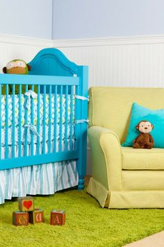 This brightly colored baby boy's nursery is filled with comfortable fabrics!