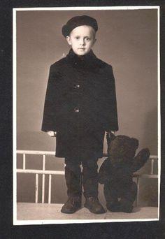 Adorable boy with Teddy bear, circa 1940.