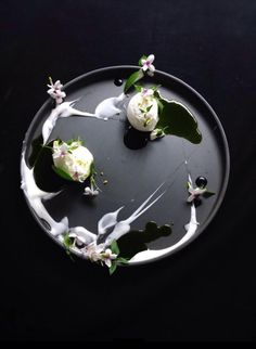ice cream decorated with flowers | Food. Art + Style. Photography: Food on black by Yann Bernard Lejard |