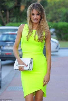 Burst of colour: Chloe wowed in a show-stopping yellow dress as she dined out in Marbella