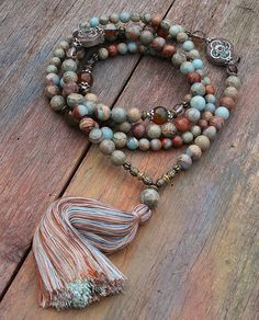 Mala made of 8 and 10 mm - 0.315 and 0.394 inch, very beautiful jasper gemstones. Together they count as 108 beads. The mala is decorated with agate, faceted cherry quartz and two Nepalese beads - look4treasures on Etsy