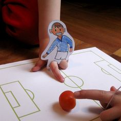 Fun soccer game for younger kids. Link provides cutouts which you can print out and colour to make your own football players and pitch.