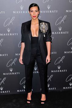 Pin for Later: Did You Get the Memo to Wear All Black to Paris's Biggest Fashion Party? Kim Kardashian The trendsetter herself wore a combination of tailored trousers and a blazer that featured an oversize brooch.