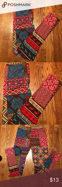 Leggings one Size Red, blue, yellow, white & brown Leggings one Size. Red, blue, yellow, white & brown.  87% Polyester and 13% Spandex. Machine wash cold gentle cycle.  Do Not BLEACH. Hang to dry.  One Size.  NW LA 12 ST Pants Leggings