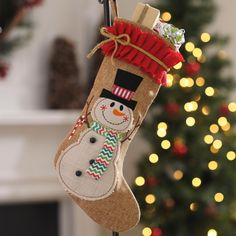Decorate your mantel with this adorable Burlap Ruffle Snowman Christmas Stocking! With it's rustic design and cute snowman decoration, this stocking will bring a smile to your face all season long.