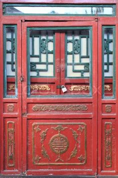 Traditional Chinese Door | Ball Lunla, via Colourbox. #portal #door #gate #traditional #chinese #front #entrance #entry #building #painted #wood #metal #bronze #brass #color #red #gold #turquoise #teal #blue #design #architecture #china #asia #travel #photography